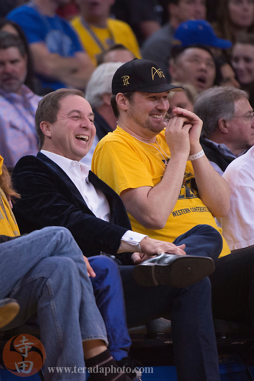 November 17, 2015; Oakland, CA, USA; Golden State Warriors owner Joe Lacob (left) sits next to professional poker player Phil Hellmuth (right) during the second quarter against the Toronto Raptors at Oracle Arena. The Warriors defeated the Raptors 115-110.