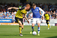 Burton Albion defender Tom Naylor (15) and Sheffield Wednesday striker Gary Hooper (14) during the EFL Sky Bet Championship match between Burton Albion and Sheffield Wednesday at the Pirelli Stadium, Burton upon Trent, England on 26 August 2017. Photo by Richard Holmes.