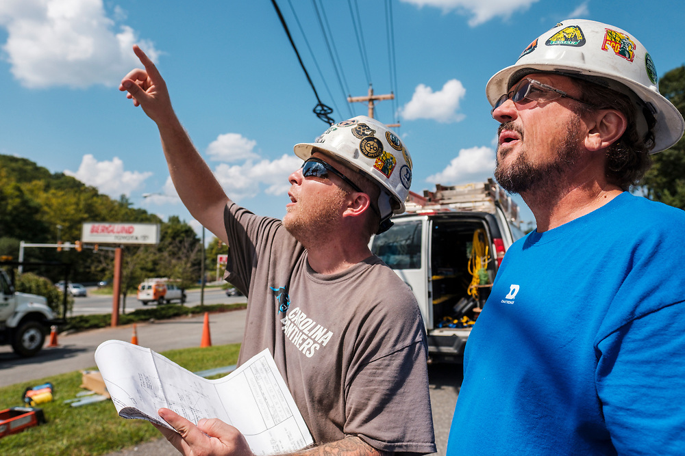 Left to right, Robert Farthing, Operations Manager at Lamar, Dwayne Mace, Regional Technician at Lamar, go discuss the progress while technicians from Lamar Advertising install a digital billboard structure along Wards Road in Lynchburg, VA Wednesday, August 29, 2018. U.S. companies are investing in re-training efforts to fill a slew of open positions as a tight labor market and changing job requirements makes it hard to find qualified staffers.<br /> CREDIT: Justin Ide for The Wall Street Journal<br /> RETRAIN