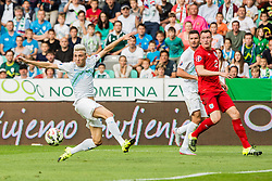 Kevin Kampl and Andraz Kirm of Slovenia and Phil Jones of England during the EURO 2016 Qualifier Group E match between Slovenia and England at SRC Stozice on June 14, 2015 in Ljubljana, Slovenia. Photo by Grega Valancic