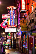 Neon signs for Crossroads, Ernest Tubbs and other honky-tonks on lower Broadway in Nashville, TN.