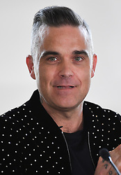 Robbie Williams attending the X Factor photocall held at Somerset House, London. Photo credit should read: Doug Peters/EMPICS