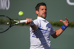 March 15, 2019 - Indian Wells, CA, U.S. - INDIAN WELLS, CA - MARCH 15: Novak Djokovic (SRB) hits a forehand during the BNP Paribas Open on March 15, 2019 at Indian Wells Tennis Garden in Indian Wells, CA. (Photo by George Walker/Icon Sportswire) (Credit Image: © George Walker/Icon SMI via ZUMA Press)