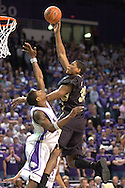 Colorado forward Julius Ashby (R) scores over Kansas State's Cartier Martin (L) in the first half.  The Buffaloes lead at halftime 30-26.