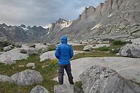 Hiker enjoying the view in Titcomb Basin, Bridger Wilderness, Wind River Range Wyoming