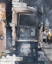 © Licensed to London News Pictures. 09/09/2019. London, UK. Fire damage to a four-storey block of flats in Worcester Park, south-west London, where twenty fire engines and more than 100 firefighters were called overnight. The fire quickly spread at around 1.30am on Monday morning on Sherbrooke Way. No casualties are reported. Photo credit: Peter Macdiarmid/LNP