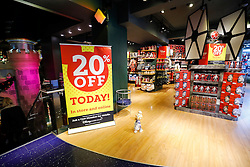 "© Licensed to London News Pictures. 25/11/2016. London, UK. Empty shopping aisles in The Disney Store on Oxford Street, London, in the early hours on ""Black Friday"". Sales from this years Black Friday event are expected to top £2 billion. Photo credit: Tolga Akmen/LNP"