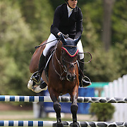 Brianne Goutal riding Orbetello in action during the $35,000 Grand Prix of North Salem presented by Karina Brez Jewelry during the Old Salem Farm Spring Horse Show, North Salem, New York, USA. 15th May 2015. Photo Tim Clayton