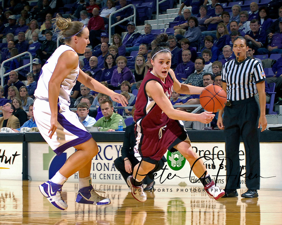 Santa Clara guard Chandice Cronk (R) drives around Kansas State's Kimberly Dietz (L) in the first half at Bramlage Coliseum in Manhattan, Kansas, December 15, 2006.  K-State defeated Santa Clara 76-52.<br />