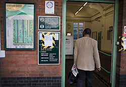 © Licensed to London News Pictures. 14/12/2016. London, UK. A passenger walks into the closed Selhurst station. Hundreds of thousands of rail passengers face a second day of a 3 day rail strike in an escalating dispute over the role of conductors and drivers. Photo credit: Peter Macdiarmid/LNP