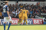 Kevin Feely of Newport is mobbed by his team-mates after scoring his side's second goal. Skybet football league two match, Newport county v Rochdale at Rodney Parade in Newport, South Wales on Saturday 3rd May 2014.<br /> pic by Mark Hawkins, Andrew Orchard sports photography.