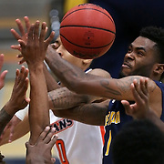 Bethesda guard Michael Walker (1) is met by a host of Cal State Fullerton defenders as he drives to the basket during the first half of the Bethesda vs. Cal State Fullerton men's college basketball game at Titan Gym on Friday, Nov.  6, 2015, in Santa Ana, Calif.<br /> <br /> Photo by Mike Christy / Sports Shooter Academy