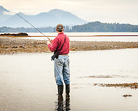 A man fishes with 8# fly fishing tackle at the mouth of a river near Sitka AK during the salmon run.