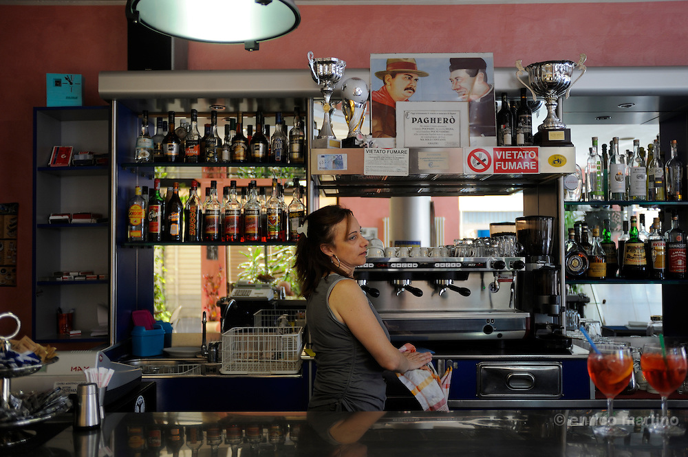 """Brescello, the traditional """"Peppone"""" coffee house on the main square. Located near the Po river this town is famous for being the set for one of Italy's most loved film series: that of Peppone and Don Camillo, played by Gino Cervi and Fernandel and based on the books by Giovannino Guareschi."""