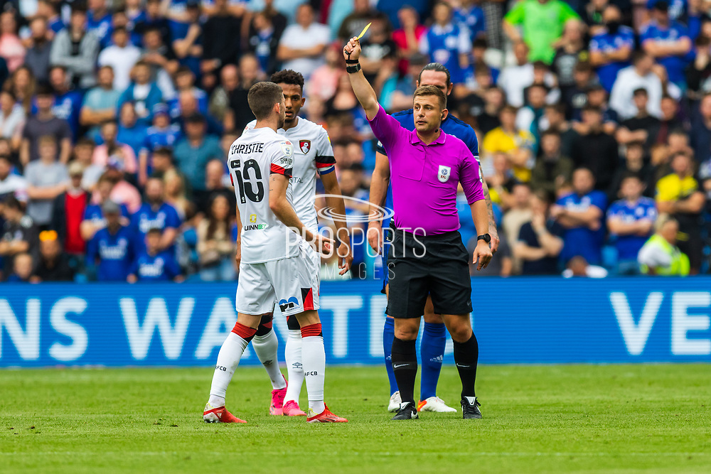 YELLOW CARD Bournemouth midfielder Ryan Christie (10) is shown a yellow card by referee Joshua Smith during the EFL Sky Bet Championship match between Cardiff City and Bournemouth at the Cardiff City Stadium, Cardiff, Wales on 18 September 2021.
