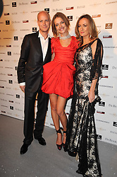 Left to right, the HON.JUSTIN PORTMAN, NATALIA VODIANOVA and LUCY YEOMANS at The Love Ball hosted by Natalia Vodianova and Lucy Yeomans to raise funds for The Naked Heart Foundation held at The Round House, Chalk Farm, London on 23rd February 2010.