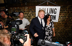 © Licensed to London News Pictures. 23/06/2016. London, UK. Boris Johnson leaves with his wife Marina Wheeler after casting his vote in the EU referendum. Polls will close at 10pm tonight, with a result expected to be announced some time after 7am tomorrow. Photo credit: Ben Cawthra/LNP