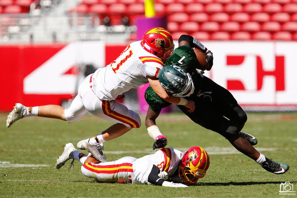 Oakdale linebacker Christian Johnson (11) tackles Manteca running back Darrion Kitson (7) during Friday Night Lights at Levi's Stadium in Santa Clara, California, on October 11, 2014. Oakdale beat Manteca 42-21. (Stan Olszewski/ Special to The Record)