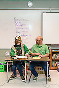 Satchel Walton, 15, a ninth-grader at DuPont Manual High School, left, and his father, Ted Walton, prepare to keep score and moderate a round of Quiz Bowl between teams Beaumont B, left, and Glasgow.<br /> <br /> Teams compete in the preliminary rounds of the 2019 Kentucky Quiz Bowl Alliance Middle School State championship Saturday, April 27, 2019, at Noe Middle School in Louisville, Ky. (Photo by Brian Bohannon)