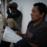 Benjamin is from La Libertad, El Salvador. He has worked in many jobs, all of them with low pay. His last job was looking after swimming pools and he carries documents to prove it, to show potential customers. Here he reads a Bible as he is waiting to board the train known as La Bestia in Apizaco, Mexico. Including elderly and young children, there are 14 people in his family, he hopes to provide for them better than he can do in El Salvador. He's never missed a day of work.
