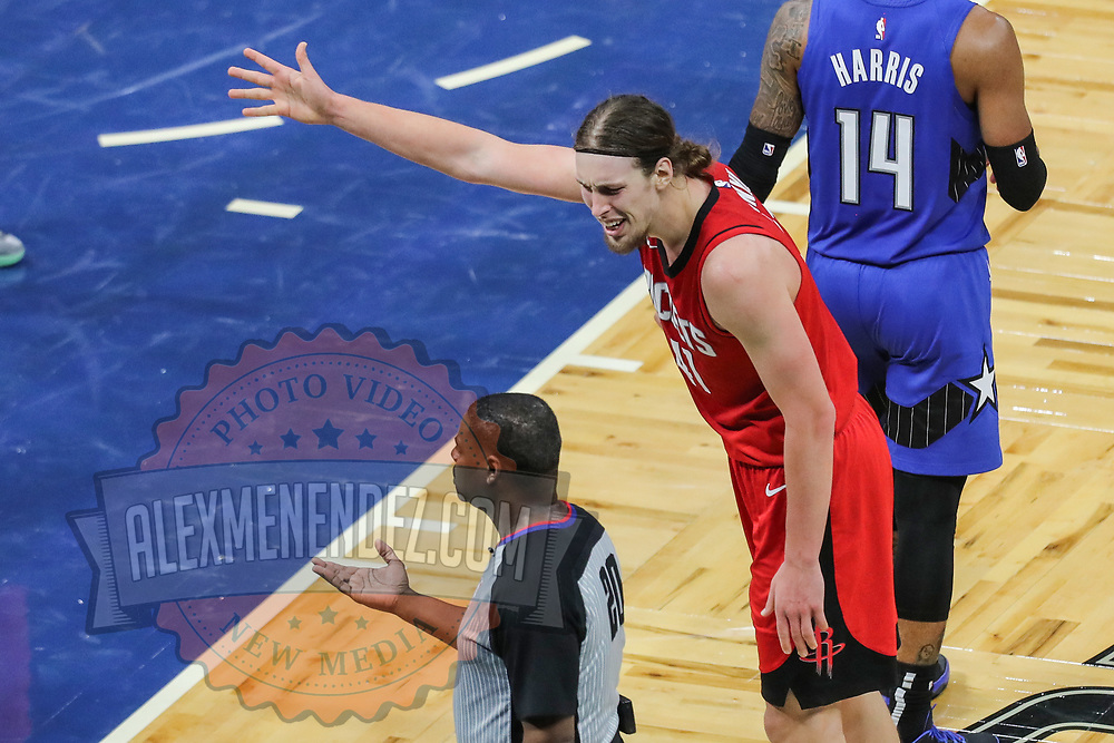 ORLANDO, FL - APRIL 18: Kelly Olynyk #41 of the Houston Rockets argues a foul call with referee Leroy Richardson #20 during the first half against the Orlando Magic at Amway Center on April 18, 2021 in Orlando, Florida. NOTE TO USER: User expressly acknowledges and agrees that, by downloading and or using this photograph, User is consenting to the terms and conditions of the Getty Images License Agreement. (Photo by Alex Menendez/Getty Images)*** Local Caption *** Kelly Olynyk; Leroy Richardson