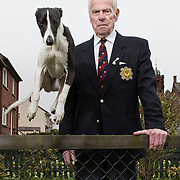 VE Day veteran John Murdoch at home in Hurlford, with his grandson's whippet 'Kane'.   Picture Robert Perry for The Herald and  Evening Times 8th May 2015<br /> <br /> Must credit photo to Robert Perry<br /> FEE PAYABLE FOR REPRO USE<br /> FEE PAYABLE FOR ALL INTERNET USE<br /> www.robertperry.co.uk<br /> NB -This image is not to be distributed without the prior consent of the copyright holder.<br /> in using this image you agree to abide by terms and conditions as stated in this caption.<br /> All monies payable to Robert Perry<br /> <br /> (PLEASE DO NOT REMOVE THIS CAPTION)<br /> This image is intended for Editorial use (e.g. news). Any commercial or promotional use requires additional clearance. <br /> Copyright 2014 All rights protected.<br /> first use only<br /> contact details<br /> Robert Perry     <br /> 07702 631 477<br /> robertperryphotos@gmail.com<br /> no internet usage without prior consent.         <br /> Robert Perry reserves the right to pursue unauthorised use of this image . If you violate my intellectual property you may be liable for  damages, loss of income, and profits you derive from the use of this image.