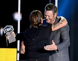 """NASHVILLE, TN - JUNE 7: Keith Urban (L) accepts the award for male video of the year for """"Blue Ain't Your Color"""" from Blake Shelton on the 2017 CMT Music Awards at the Music City Center on June 7, 2017 in Nashville, Tennessee. (Photo by Laura Farr/PictureGroup) *** Please Use Credit from Credit Field ***"""
