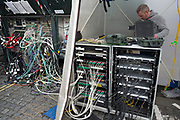 Television technician working amongst equipment and complicated wires prior to the broadcast of the BAFTA Awards in London, England, United Kingdom. (photo by Mike Kemp/In Pictures via Getty Images)