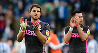 Leeds United's Gaetano Berardi, left, and Leeds United's Jack Harrison applaud the fans at the final whistle <br /> <br /> Photographer Chris Vaughan - CameraSport<br /> <br /> The EFL Sky Bet Championship - Huddersfield Town v Leeds United - Saturday 7th December 2019 - John Smith's Stadium - Huddersfield<br /> <br /> World Copyright © 2019 CameraSport. All rights reserved. 43 Linden Ave. Countesthorpe. Leicester. England. LE8 5PG - Tel: +44 (0) 116 277 4147 - admin@camerasport.com - www.camerasport.com