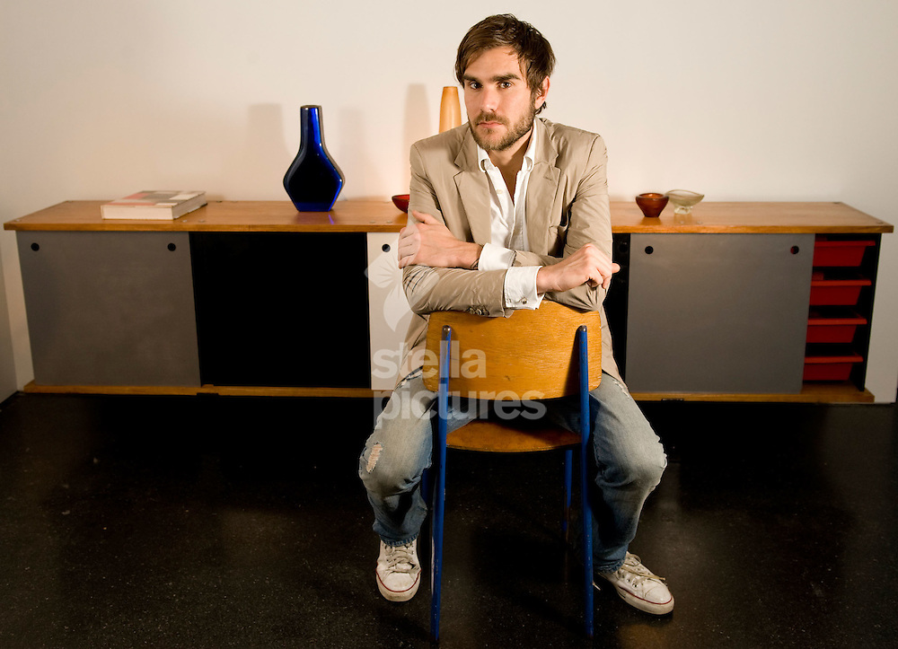 Picture by Daniel Hambury..26/05/09..British art dealer, Oscar Humphries pictured sitting on a Jean Prouve chair infront of a Charlotte Perriand cabinet in Mayfair gallery 'Sebastian + Barquet in London..