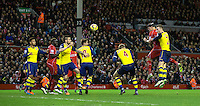 Liverpool's Martin Skrtel gets in front of Arsenal's Calum Chambers to head his sides equalising goal to make the score 2-2 in the last minutes of the match<br /> <br /> Photographer Stephen White/CameraSport<br /> <br /> Football - Barclays Premiership - Liverpool v Arsenal - Sunday 21st December 2014 - Anfield - Liverpool<br /> <br /> © CameraSport - 43 Linden Ave. Countesthorpe. Leicester. England. LE8 5PG - Tel: +44 (0) 116 277 4147 - admin@camerasport.com - www.camerasport.com