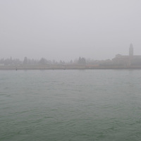 VENICE, ITALY - JANUARY 16: San Michele Island under thick fog seen from a boat on January 16, 2011 in Venice, Italy. Transports in the lagoon has been affected by today's fog.