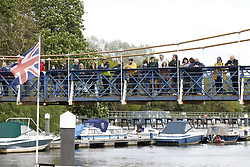 © Licensed to London News Pictures. 10/05/2021. London, UK. An RNLI crew and members of the public look on as a young minke whale is trapped in the River Thames at Teddington Lock in south west London. Fire crews and the British Divers Marine Life group worked with an Rescue Royal National Lifeboat Institute (RNLI) crew in an eff cinnamonort to save the whale after it got stuck last night. But it is now free . Photo credit: Peter Macdiarmid/LNP