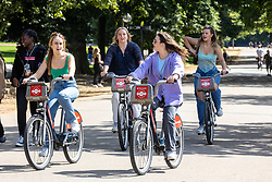 Licensed to London News Pictures. 25/08/202. London, UK. Cyclists enjoy the warm sunshine and highs of 24c in Hyde Park, London today. Weather forecaster predict the mild weather will continue this week with highs of 22c for the Bank Holiday weekend. Photo credit: Alex Lentati/LNP
