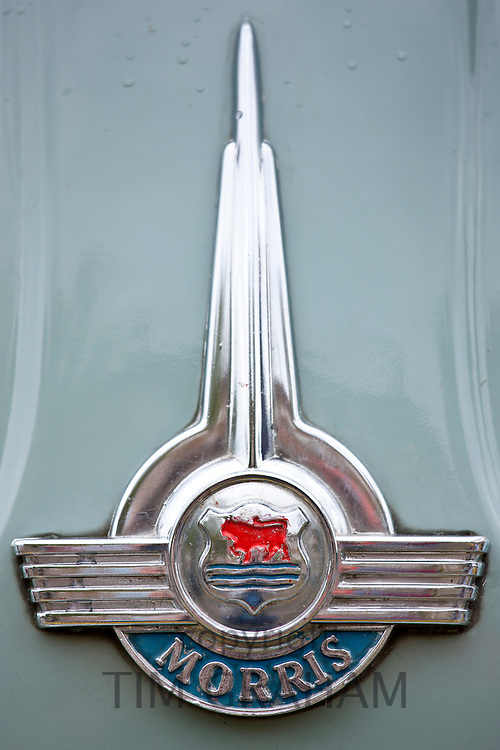 Logo of Morris Minor 1000 car at classic car rally at Brize Norton in Oxfordshire, UK