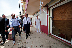 France's President Emmanuel Macron looks at damaged houses destroyed by Irma during his visit in the French Caribbean islands of St. Martin, Tuesday, Sept. 12, 2017. Macron is in the French-Dutch island of St. Martin, where 10 people were killed on the French side and four on the Dutch. Photo by Christophe Ena/Pool/ABACAPRESS.COM