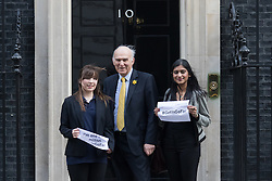 © Licensed to London News Pictures. 10/03/2015. London, UK. Vince Cable with his two apprentices, Paige McConville and Pallavi Boppana arrive for a cabinet meeting at 10 Downing Street in London on Tuesday 10th March 2015. Photo credit : Vickie Flores/LNP