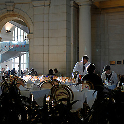 WASHINGTON, DC - A waiter pours refreshments for diners at America, one of several dining options at Washington, DC's Union Station...Photo by Susana Raab