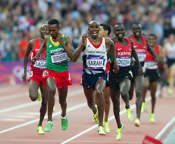 © Licensed to London News Pictures. 11/08/2012. London,Britain.Britain's Mohamed Farah wins the men's 5000m final at the London 2012 Olympic Games Athletics, Track and Field events at the Olympic Stadium.  Photo credit : Bogdan Maran/LNP/BPA