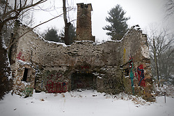 The ruined remains of a cottage sits in a snow covered meadow in Northwest section of Philadelphia, PA as the region braces for the 'Bomb Cyclone' winter storm Grayson, on January 4, 2018.
