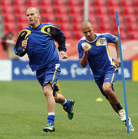Photo: Chris Ratcliffe.<br />Sweden Training Session. FIFA World Cup 2006. 19/06/2006.<br />Henrik Larsson and Freddie Ljungberg in training.