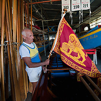 """VENICE, ITALY - SEPTEMBER 04:  A member of the Voga Veneta Lido arranges a """"Serenissma"""" flag  during preparations  ahead of Sunday Historic Regata on September 4, 2010 in Venice, Italy. The Historic Regata is the most exciting rowing race on the Gran Canal for the locals and one of the most spectacular ***Agreed Fee's Apply To All Image Use***.Marco Secchi /Xianpix. tel +44 (0) 207 1939846. e-mail ms@msecchi.com .www.marcosecchi.com"""