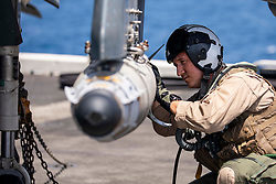 May 20, 2019 - Arabian Sea - Maj. Joseph Swindell, an AV-8B Harrier pilot assigned to the 22nd Marine Expeditionary Unit (MEU), inspects a GBU-54 joint direct attack munition during pre-flight checks on the flight deck of the Wasp-class amphibious assault ship USS Kearsarge (LHD 3). Kearsarge is the flagship for the Kearsarge Amphibious Ready Group (ARG). The Kearsarge ARG, along with the embarked 22nd MEU, is prepared to respond to contingencies and to defend U.S. forces and interests in the region. (Credit Image: © U.S. Navy/ZUMA Wire/ZUMAPRESS.com)