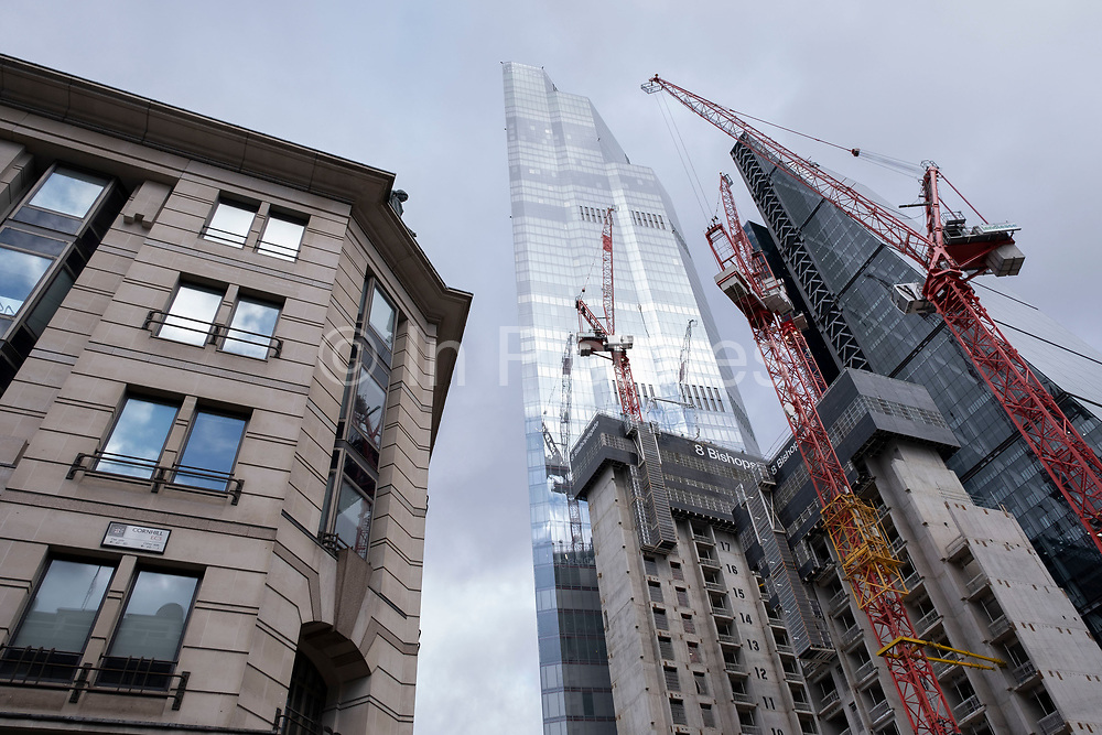 View looking up at the construction site for the latest skyscraper in the City of London at 8 Bishopsgate on 29th January 2021 in London, United Kingdom. The City of London is a city, county and a local government district that contains the historic centre and the primary central business district CBD of London, and is now known for being full of skyscrapers.