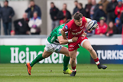 Scarlets' Steff Evans is tackled by Benetton Treviso's Tommaso Benvenuti - Mandatory by-line: Craig Thomas/JMP - 09/12/2017 - RUGBY - Parc y Scarlets - Llanelli, Wales - Scarlets v Benetton Rugby - European Rugby Champions Cup