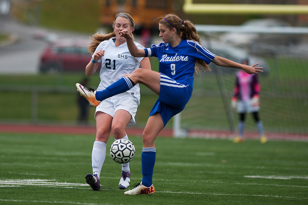 Burlington's Pascal Gulick (21) and U-32'a Maya Mashkuri (9) battle for the ball during the girls playoff soccer game between the U-32 Raiders and the Burlington Sea Horses at Buck Hard Field on Friday afternoon October 24, 2014 in Burlington, Vermont (BRIAN JENKINS, for the Free Press)