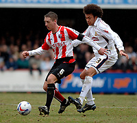 Photo: Daniel Hambury.<br />Brentford v Doncaster Rovers. Coca Cola League 1. 25/03/2006.<br />Brentford's Ricky Newman and Doncaster's Jason Price battle.