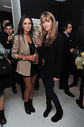 Left to right, ROXIE NAFOUSI and DAISY DODD-NOBLE at a private view of Russell Young's work entitled American Envy held at Scream Gallery, 34 Bruton Street, London on 7th April 2011.