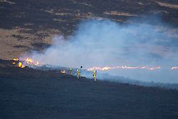 © Licensed to London News Pictures. 27/02/2019. Marsden UK. Fire crews are fighting a huge fire on Saddleworth moor this morning near the town of Marsden in Yorkshire. Photo credit: Andrew McCaren/LNP