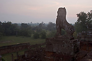 "Pre Rup, which means ""turning the body"" in reference to a cremation ritual, is a tall grand towered temple made from laterite and brick. Pre Rup is a state-temple of Rajendravarman II, and was consecrated to Shiva in 962. Stone lions guard each of the four stair cases which lead up the temple, as they stand looking out over the surrounding green paddy fields."